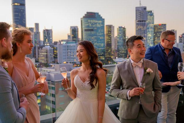 The point kangaroo point weddings venue bride groom mingling